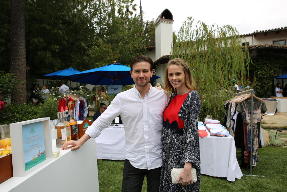 Torrance Coombs and Alyssa Campanella hang out by the Casamigos booth.