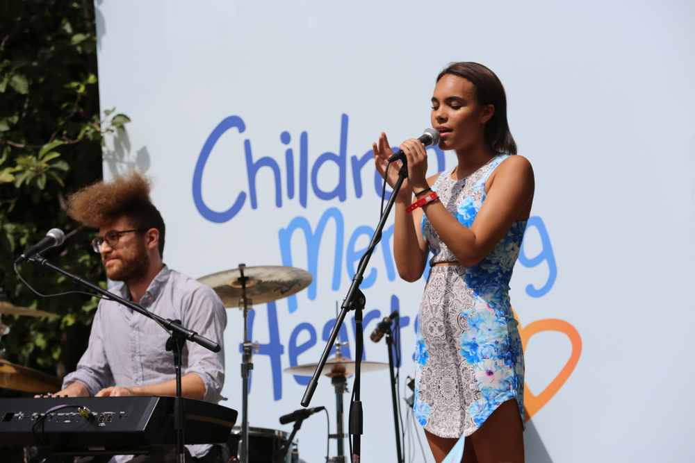 Maya Heslov, our founder's beautiful daughter, serenaded the crowd with her stage performance debut.