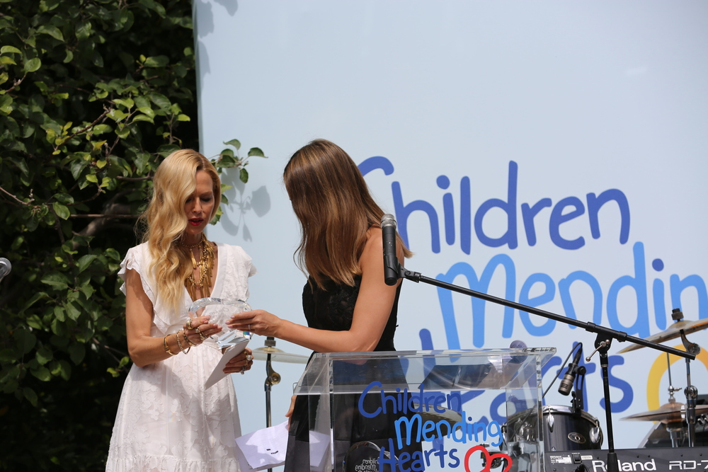 Jessica presents Rachel with the Humanitarian of the year award.