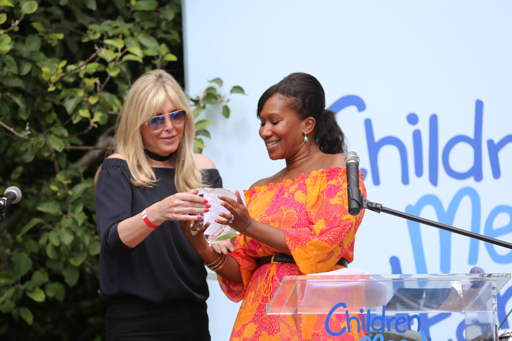 Irena Medavoy is presented with the Ambassador of Peace Award by Ambassador Nicole Avant