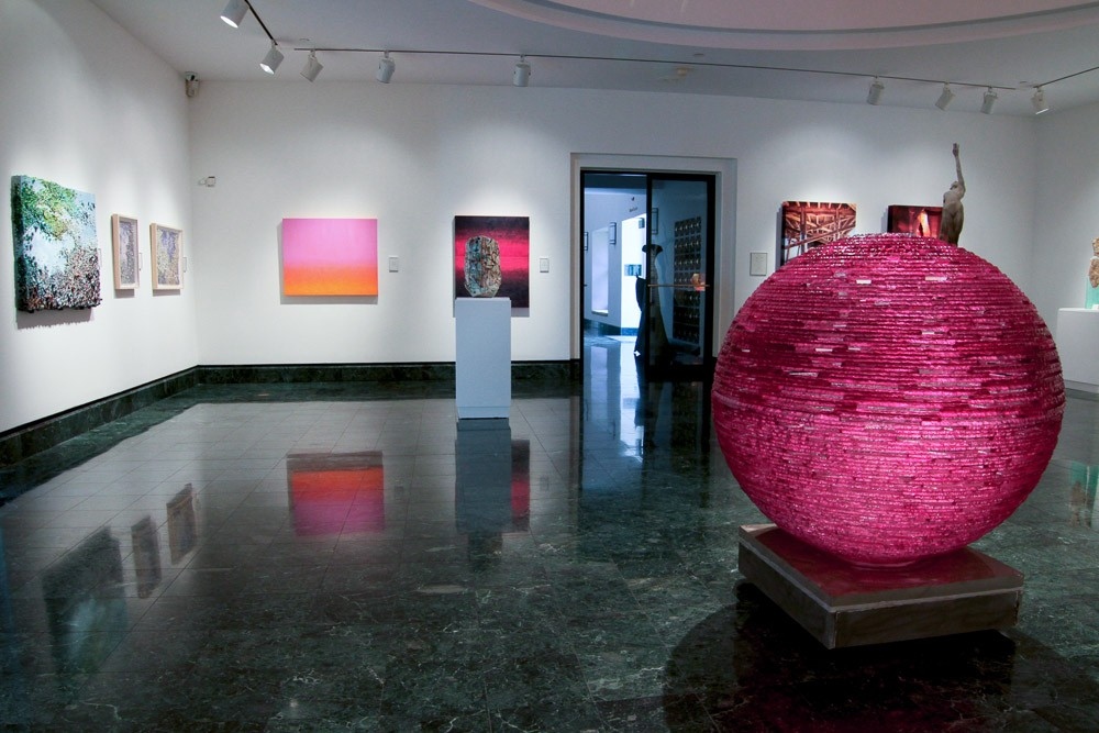 Magenta fractured glass orb in gallery setting