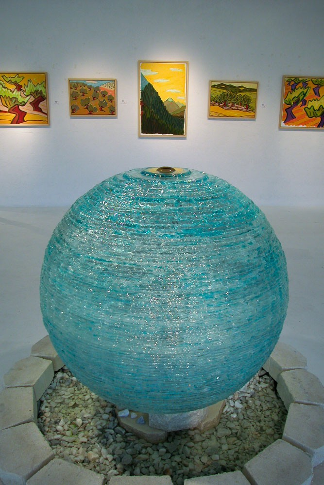 Glass orb in museum setting