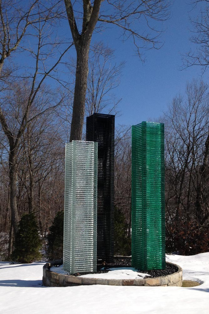 Three Graces at Seven Bridges, triple glass column sculpture