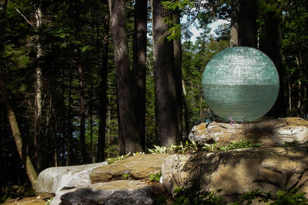 Large fractured plate glass orb sculpture, sphere