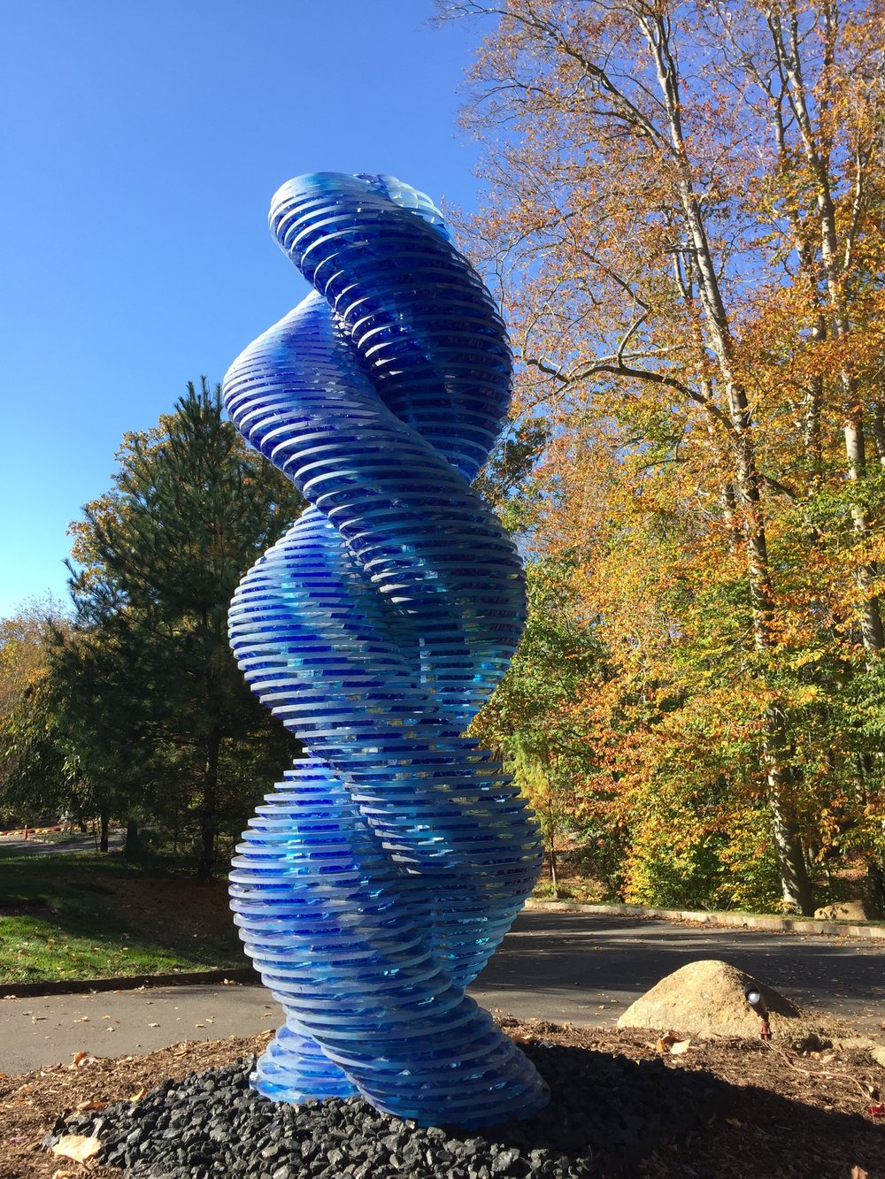 Seven foot twisted blue glass tower, landscape sculpture