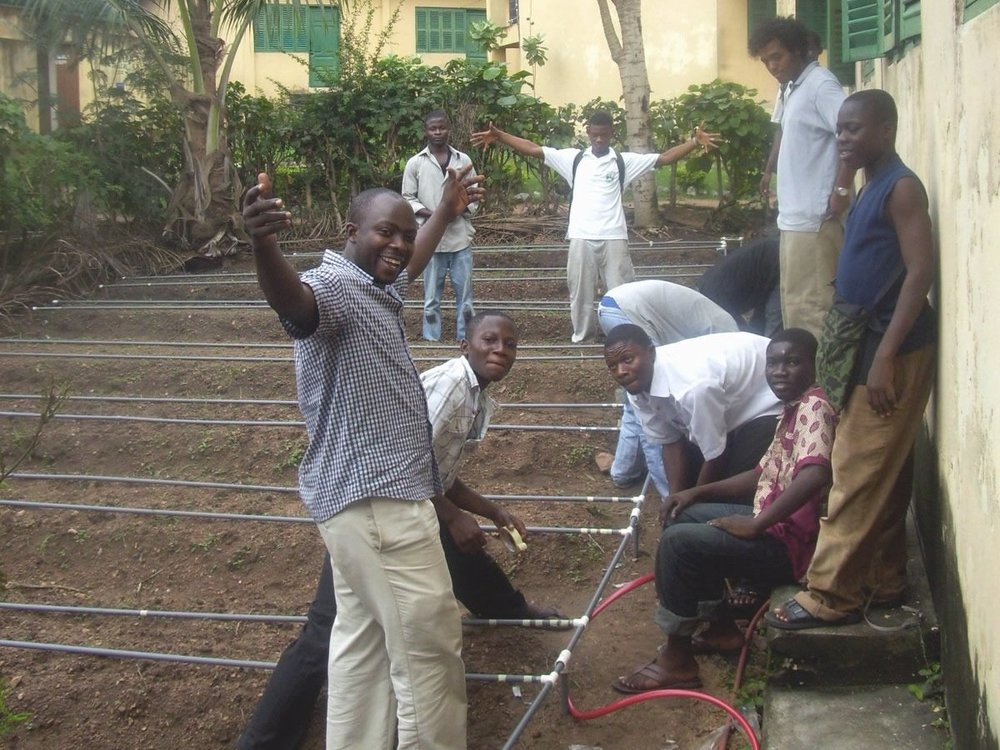 Camp participants with ELiTE Co-Founder, Chelsey Roebuck, and Ghana Telecom University EWB President, Samuel Gamson, installing drip irrigation system at Nsawam Senior High School in 2009.