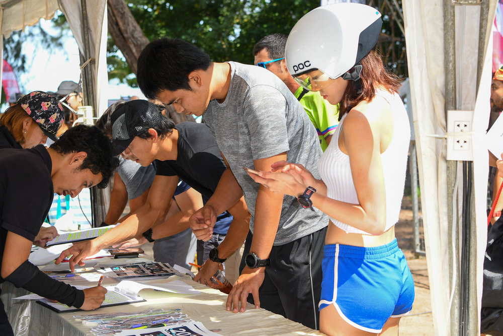 KRABI, THAILAND - JULY 22: Athletes and participants registering to race in the Krabi International Triathlon on July 22, 2017 at Nopharat Thara Beach, Krabi, Thailand. (Photo by: Naratip Srisupab/Thailand Photo SEALs Sports Photography)