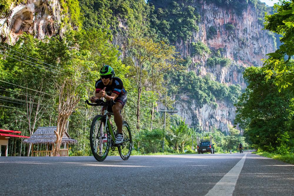 KRABI, THAILAND - JULY 23: Athletes and participants on the cycle leg during Krabi International Triathlon on July 23, 2017 at Nopharat Thara Beach, Krabi, Thailand. (Photo by: Naratip Srisupab/Thailand Photo SEALs Sports Photography)
