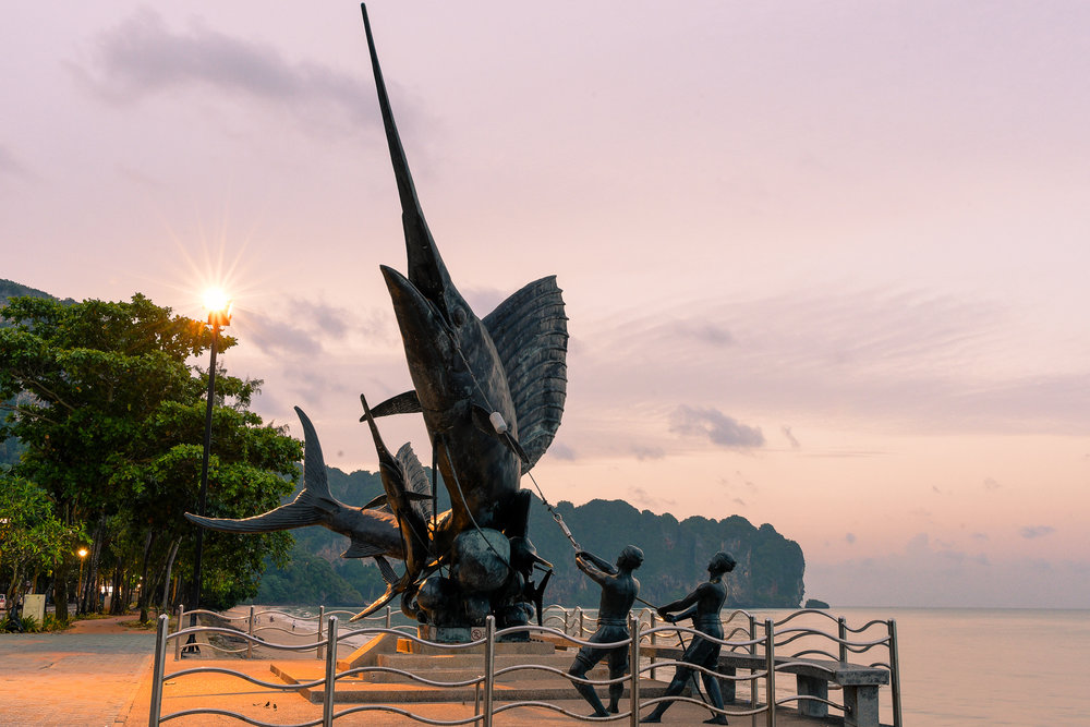 KRABI, THAILAND - JULY 22: Sunrise over Swordfish Statue in Aonang where athletes and participants will make a u-turn back to the finish line during Krabi International Triathlon Registration Day at Nopharat Thara Beach on July 22, 2017 in Krabi, Thailand. (Photo by: Naratip Srisupab/Thailand Photo SEALs Sports Photography)