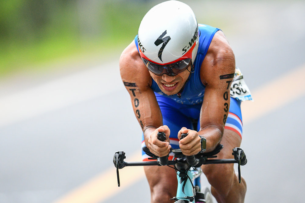 TRANG, THAILAND - AUGUST 27: Jaray Jearanai of Thailand on the cycling course in the TRANG THRILLING TRIATHLON 2017 on August 27, 2017 in Chao Mai National Park, Sikao, Trang, Thailand. (Photo by: Naratip Srisupab/Thailand Photo SEALs Sports Photography)