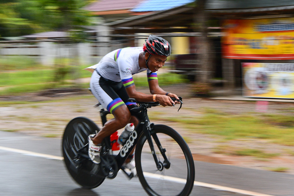 TRANG, THAILAND - AUGUST 27: Ekkarat Ricky Phantip of Thanyapura Phuket on the cycling course in the TRANG THRILLING TRIATHLON 2017 on August 27, 2017 in Chao Mai National Park, Sikao, Trang, Thailand. (Photo by: Naratip Srisupab/Thailand Photo SEALs Sports Photography)