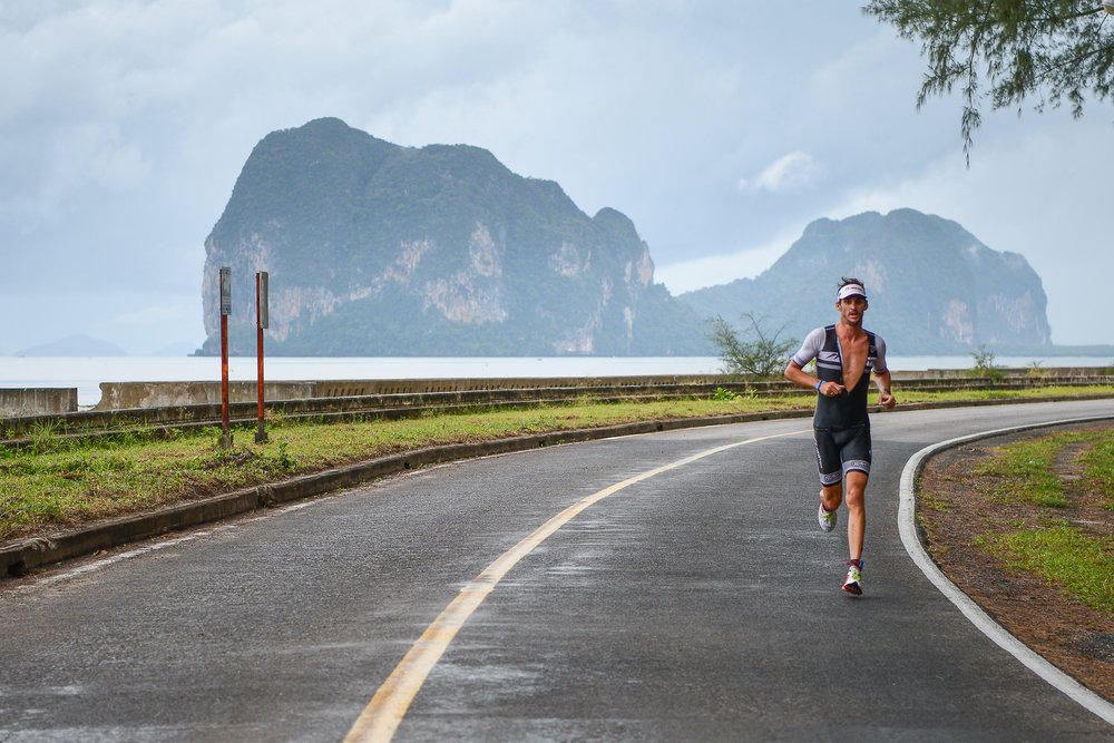 TRANG, THAILAND - AUGUST 27: Mitchell Robins of Australia running on the final leg in the TRANG THRILLING TRIATHLON 2017 on August 27, 2017 in Chao Mai National Park, Sikao, Trang, Thailand. (Photo by: Naratip Srisupab/Thailand Photo SEALs Sports Photography)