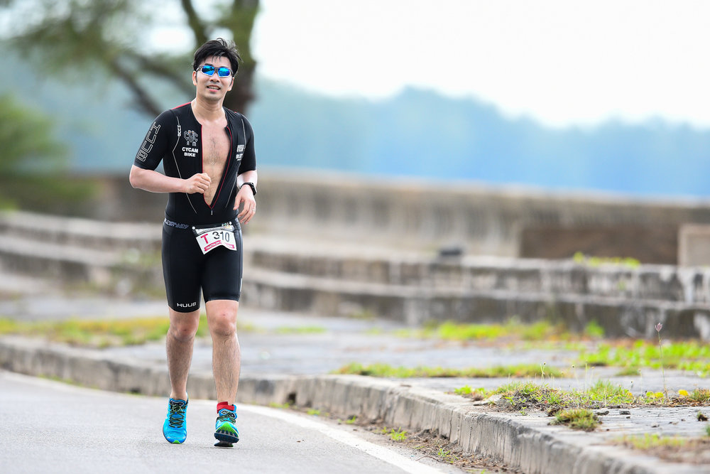 TRANG, THAILAND - AUGUST 27: Thailand famous singer and actor James Ruangsak Loychusak on the running course for team T310 relay in the TRANG THRILLING TRIATHLON 2017 on August 27, 2017 in Chao Mai National Park, Sikao, Trang, Thailand. (Photo by: Naratip Srisupab/Thailand Photo SEALs Sports Photography)