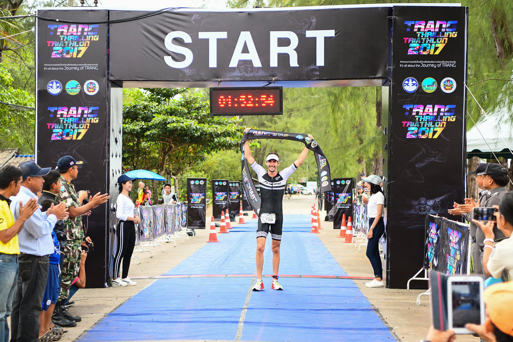 TRANG, THAILAND - AUGUST 27: Mitchell Robins of Australia crossings the finish line with an official time of 1:52:39 in the TRANG THRILLING TRIATHLON 2017 on August 27, 2017 in Chao Mai National Park, Sikao, Trang, Thailand. (Photo by: Naratip Srisupab/Thailand Photo SEALs Sports Photography)