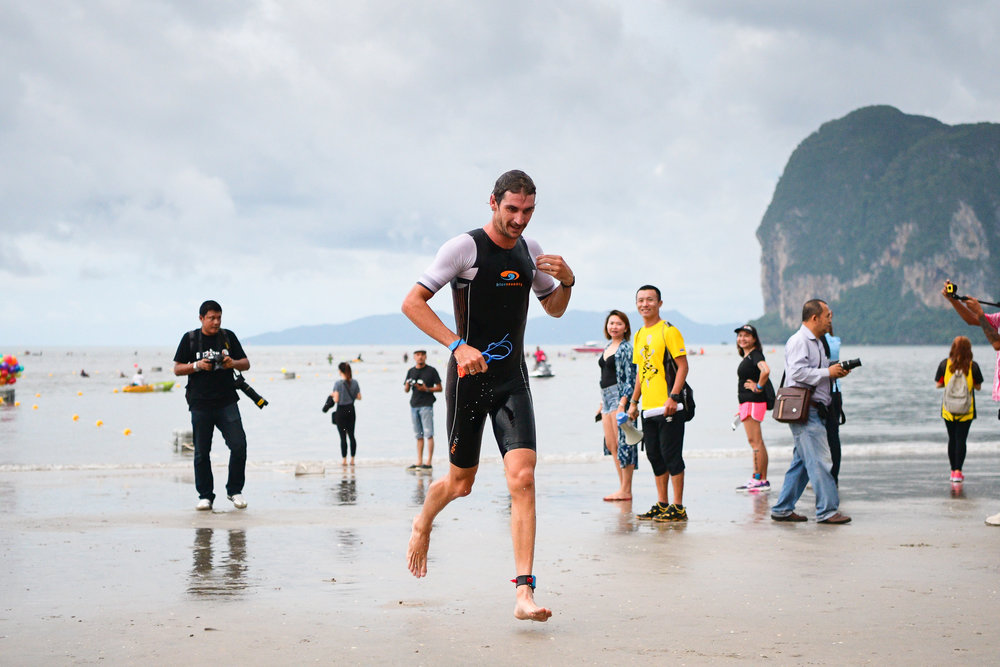 TRANG, THAILAND - AUGUST 27: Mitchell Robins of Australia heading to the transition area where he will begin his cycling course in the TRANG THRILLING TRIATHLON 2017 on August 27, 2017 in Chao Mai National Park, Sikao, Trang, Thailand. (Photo by: Naratip Srisupab/Thailand Photo SEALs Sports Photography)