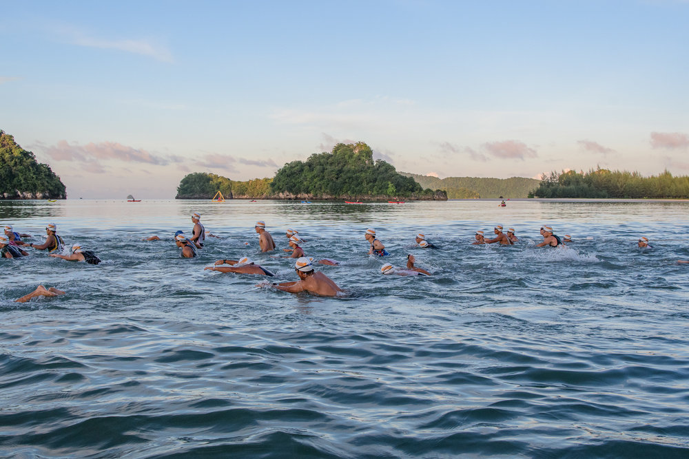 KRABI, THAILAND - SEPTEMBER 03: First wave of the race: Standard Race is on their way swimming 1.4km at KANABNAM INTERNATIONAL TRIATHLON KRABI 2017 on September 03, 2017 in Nopparat Thara Beach, Ao Nang , Krabi, Thailand. (Photo by: Naratip Srisupab/Thailand Photo SEALs Sports Photography)