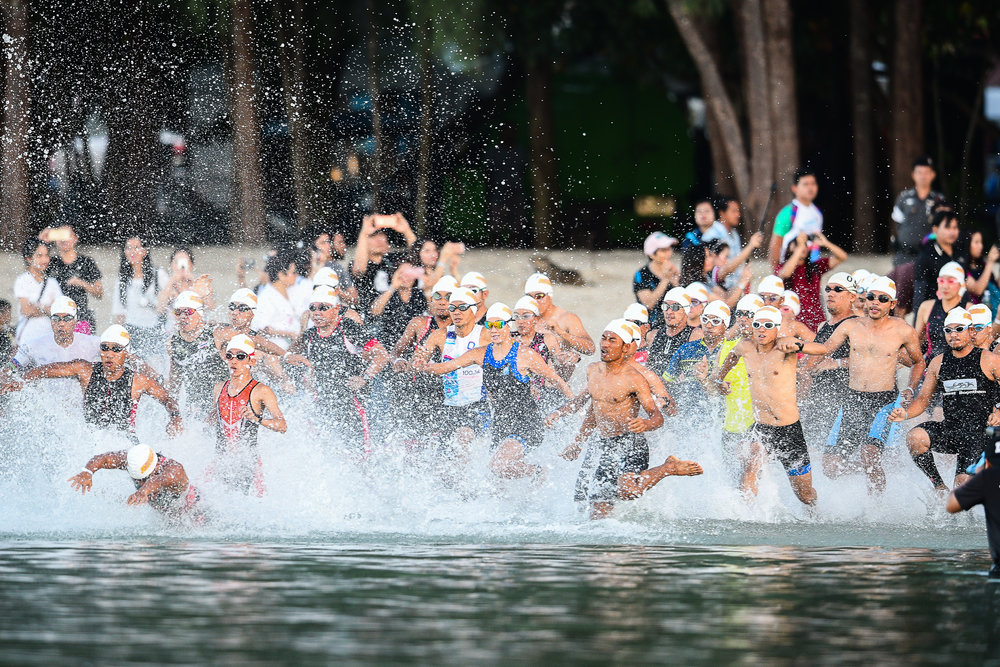 KRABI, THAILAND - SEPTEMBER 03: The start of the Sprint Race as they enter the water with special guest Manow Phoranee Sritan at KANABNAM INTERNATIONAL TRIATHLON KRABI 2017 on September 03, 2017 in Nopparat Thara Beach, Ao Nang , Krabi, Thailand. (Photo by: Naratip Srisupab/Thailand Photo SEALs Sports Photography)