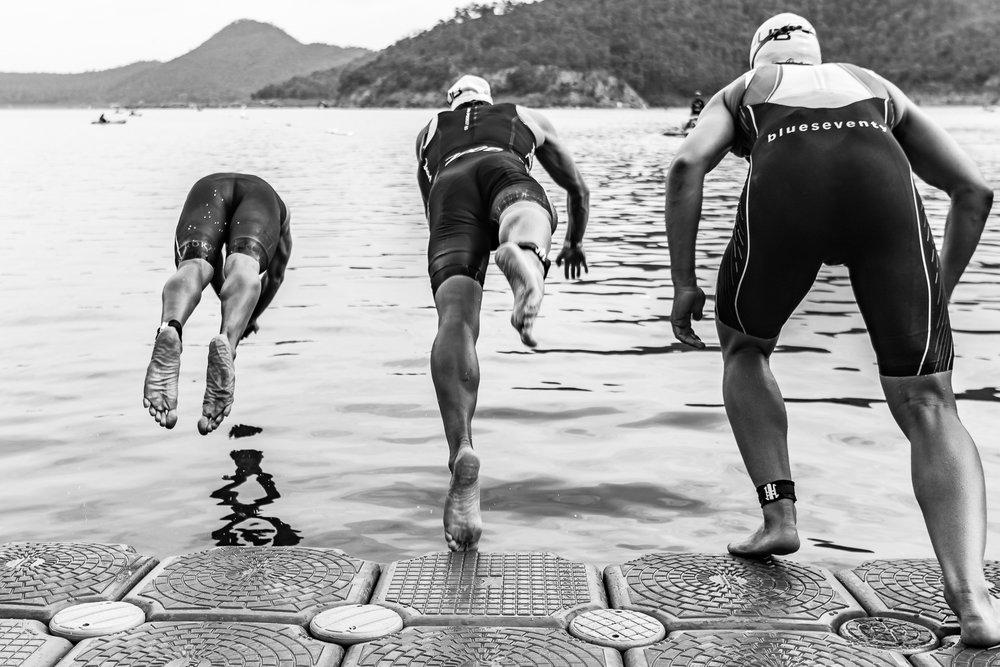 KANCHANABURI, THAILAND - OCTOBER 23: (This image has been converted to black and white.) Men's Professional Triathletes are off to start Challenge Kanchanaburi Triathlon race on October 23, 2016 in Srinakarind Dam, Kanchanaburi, Thailand. (Photo by: Naratip Srisupab/Thailand Photo SEALs Sports Photography)