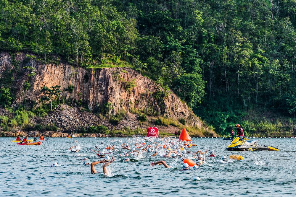 KANCHANABURI, THAILAND - OCTOBER 23: Athletes swimming in the dam during Challenge Kanchanaburi Triathlon on October 23, 2016 in Srinakarind Dam, Kanchanaburi, Thailand. (Photo by: Naratip Srisupab/Thailand Photo SEALs Sports Photography)