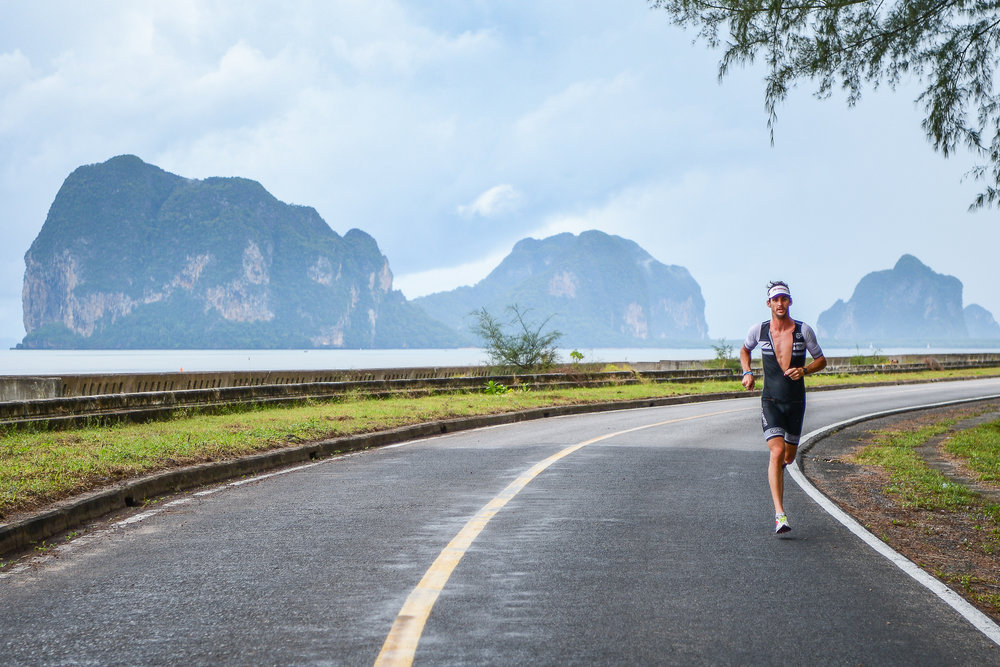 TRANG, THAILAND - AUGUST 27: Mitchell Robins of Australia running 10k during Trang Thrilling Triathlon 2017 on August 27, 2017 in Chao Mai National Park, Trang, Thailand. (Photo by: Naratip Srisupab/Thailand Photo SEALs Sports Photography)