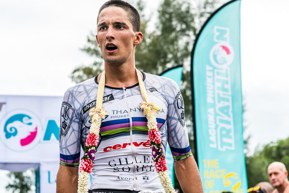 PHUKET, THAILAND - NOVEMBER 14: Antony Costes of France crosses the finish line during Laguna Phuket Triathlon 2016 on July 14, 2017 at Laguna Phuket, Phuket, Thailand. (Photo by: Naratip Srisupab/Thailand Photo SEALs Sports Photography)
