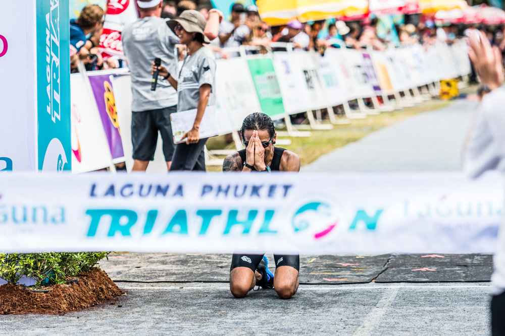 "PHUKET, THAILAND - NOVEMBER 20: Thailand famous rock star of BodySlam - Artiwara ""Toon"" Kongmalai at the finish line during Laguna Phuket Triathlon 2016 on November 20, 2016 at Laguna Phuket, Phuket, Thailand. (Photo by: Naratip Srisupab/Thailand Photo SEALs Sports Photography)"