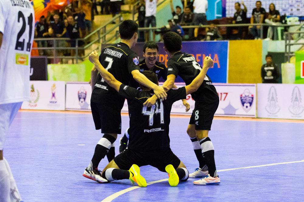 SURAT THANI, THAILAND - JUNE 11: Surat Thani Chargers celebrate a goal during the Surat Thani vs Samut Sakhon Futsal on June 11, 2017 at Surat Thani Sports Complex, Surat Thani, Thailand. (Photo by: Naratip Srisupab/Thailand Photo SEALs Sports Photography)