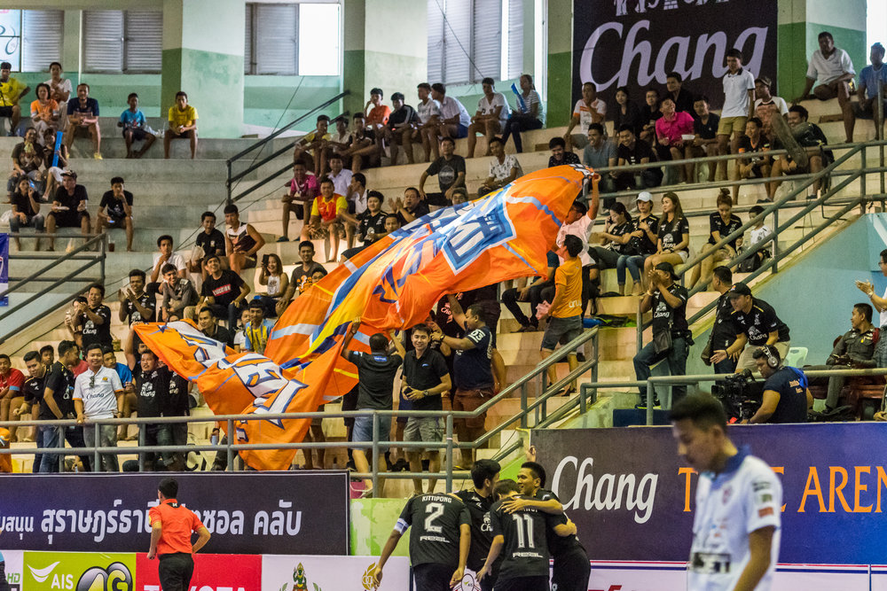 SURAT THANI, THAILAND - JUNE 11: Surat Thani Chargers fans going wild as they take a 1 up lead against Samut Sakhon at Surat Thani vs Samut Sakhon Futsal on June 11, 2017 at Surat Thani Sports Complex, Surat Thani, Thailand. (Photo by: Naratip Srisupab/Thailand Photo SEALs Sports Photography)