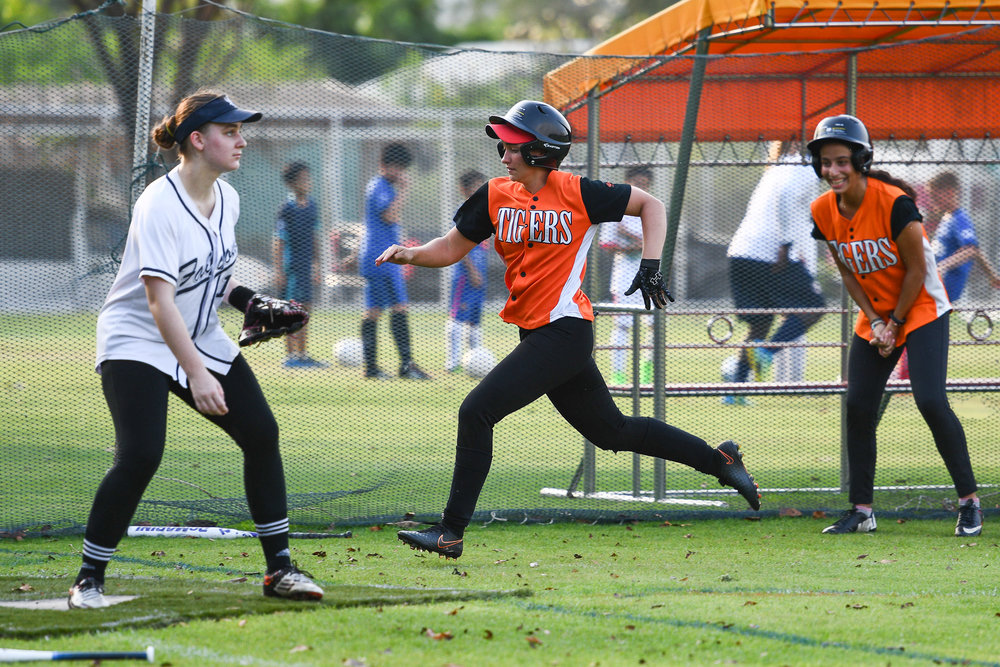 BANGKOK, THAILAND - MARCH 14: Bangkok Pattana Tigers Home Game vs NIST Falcons during the BISAC Varsity Girls Softball 2016/17 Season on July 14, 2017 at Sports Complex Bangkok Pattana, Bangkok, Thailand. (Photo by: Naratip Srisupab/Thailand Photo SEALs Sports Photography)