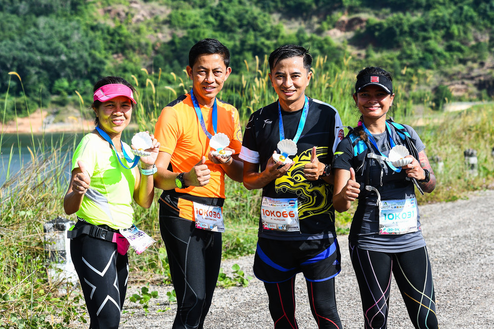 PHUKET, THAILAND - JUNE 18: Participants with their finishing medals at the Andaman Trails 2017 on June 18, 2017 at Ban Bang Niew Dam Reservoir Project, Phuket, Thailand. (Photo by: Naratip Srisupab/Thailand Photo SEALs Sports Photography)