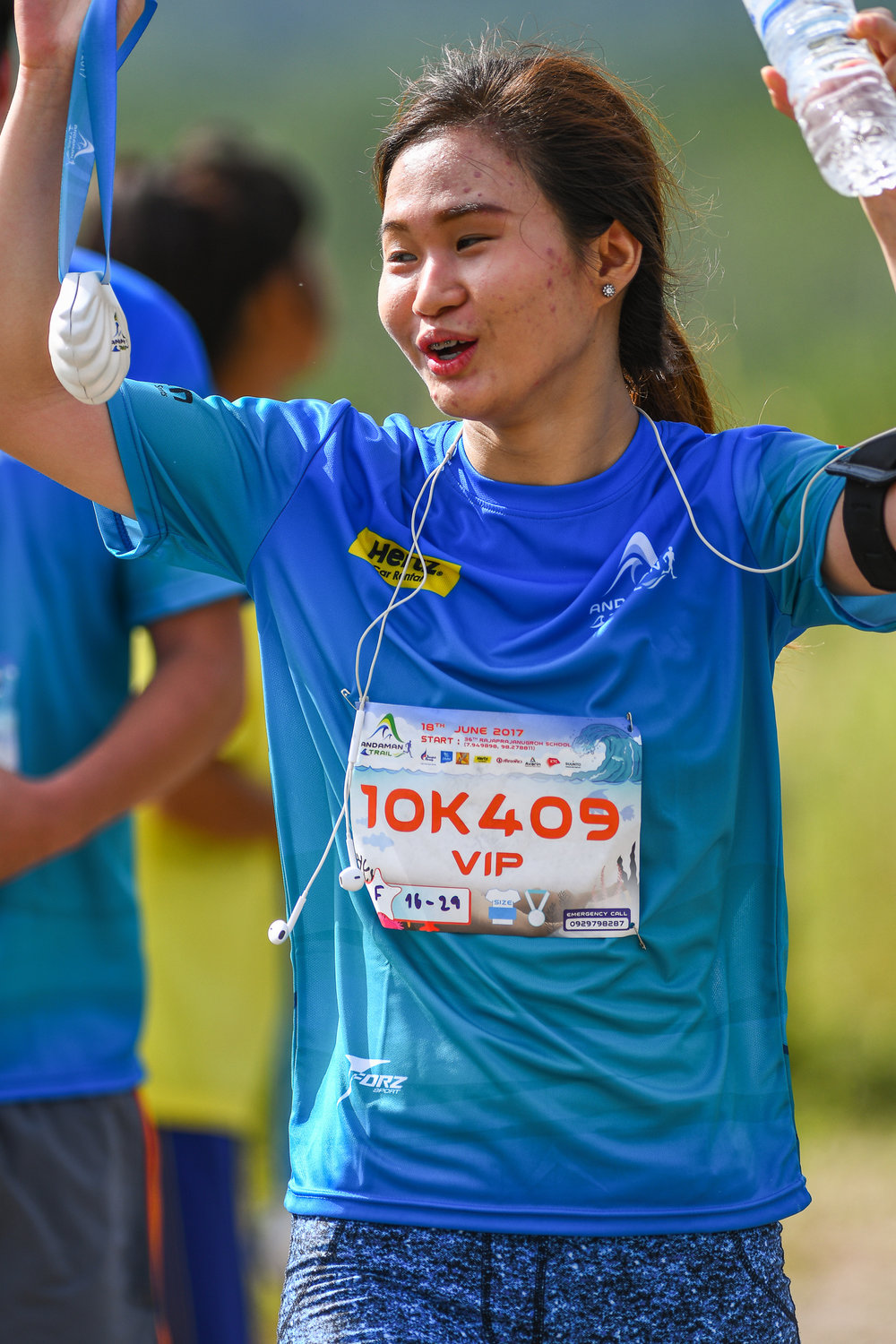 PHUKET, THAILAND - JUNE 18: Participant with her finishing medal at the Andaman Trails 2017 on June 18, 2017 at Ban Bang Niew Dam Reservoir Project, Phuket, Thailand. (Photo by: Naratip Srisupab/Thailand Photo SEALs Sports Photography)