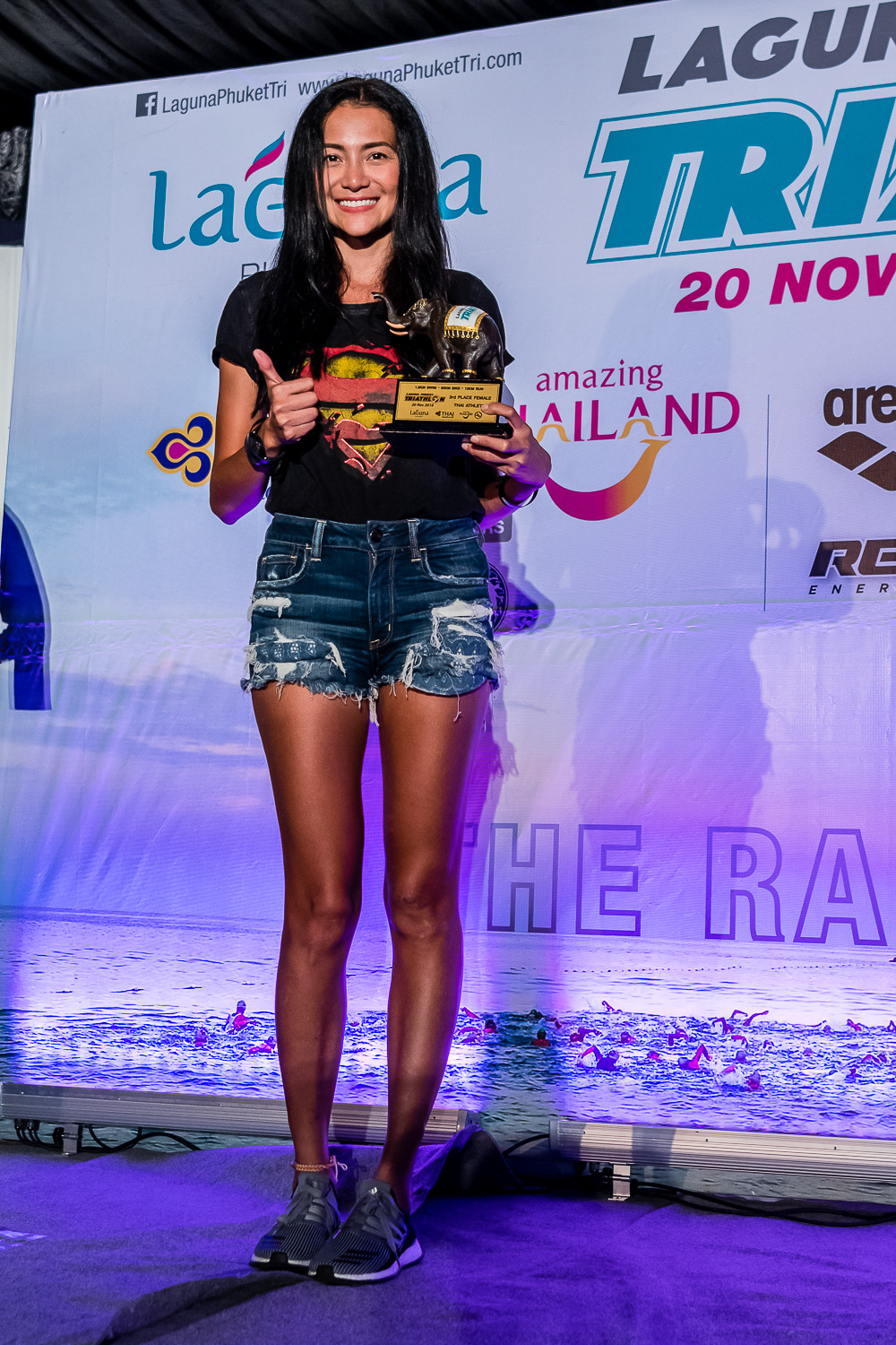 PHUKET, THAILAND - NOVEMBER 20: Yossavadee Hassadeevichit	of Thailand receiving her trophy at Laguna Phuket Triathlon 2016 Banquet on November 20, 2016 at Laguna Phuket, Thailand. (Photo by: Naratip Srisupab/Thailand Photo SEALs Sports Photography)