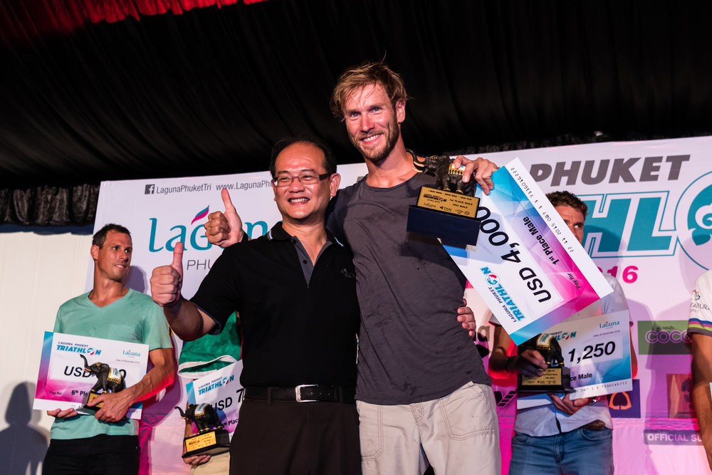 PHUKET, THAILAND - NOVEMBER 20: Michael Raelert of Germany receiving his awards during the Laguna Phuket Triathlon 2016 Banquet on November 20, 2016 at Laguna Phuket, Thailand. (Photo by: Naratip Srisupab/Thailand Photo SEALs Sports Photography)