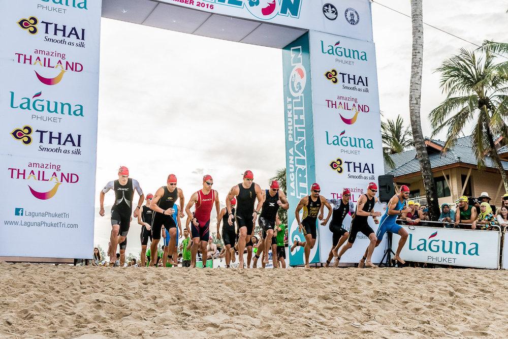 PHUKET, THAILAND - NOVEMBER 20: Men's Professional Triathletes are off to start the Laguna Phuket Triathlon 2016 race on November 20, 2016 at Laguna Phuket, Phuket, Thailand. (Photo by: Naratip Srisupab/Thailand Photo SEALs Sports Photography)