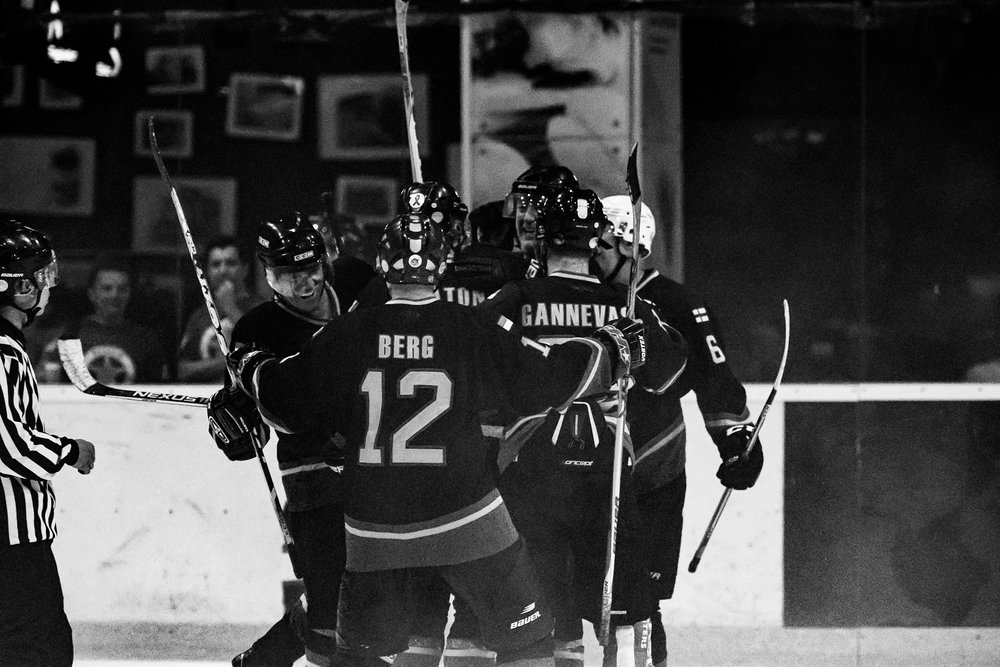 BANGKOK, THAILAND - MARCH 30: (This image has been converted to black and white.) Jakarta Dragons celebrate after scoring against Abu Dhabi Scorpions during the JOG City of Angels Ice Hockey Classic 2017 on March 30, 2017 at The Rink Central Rama IX, Bangkok, Thailand. (Photo by: Naratip Srisupab/Thailand Photo SEALs Sports Photography)