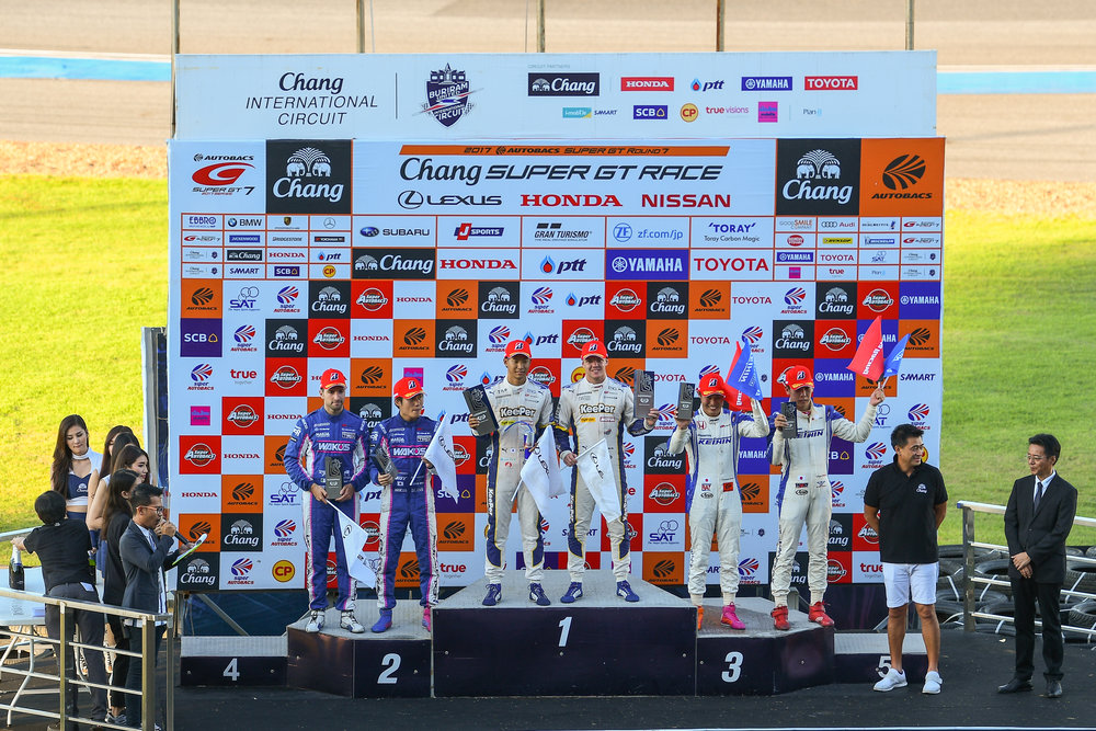 BURIRAM, THAILAND - OCTOBER 08: GT-500 Podium Ceremony, 1st Place: Riyo Hirakawa / Nick Cassidy, 2nd Place: Kazuya Oshima / Andrea Caldarelli, and in 3rd Place: Koudai Tsukakoshi / Takashi Kogure at the AUTOBACS Chang Super GT Round 7 Race 2017, Chang International Circuit, Buriram, Thailand on October 08, 2017. (Photo by: Naratip Srisupab/SEALs Sports Images)
