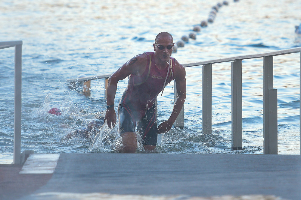 PHUKET, THAILAND - NOVEMBER 19: Alex Polizzi of Australia coing of the swim at Laguna Phuket Triathlon 2017 at Laguna Phuket, Cherngtalay, Phuket, Thailand on November 19, 2017. (Photo by: Naratip Srisupab/SEALs Sports Images)