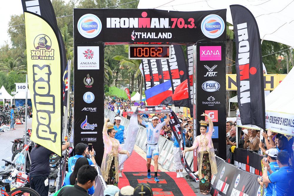 PHUKET, THAILAND - NOVEMBER 26: Markus Rolli of Germany crosses the finishing line at Foremost Ironman 70.3 Thailand 2017 at Laguna Phuket, Cherngtalay, Phuket, Thailand on November 26, 2017. (Photo by: Naratip Srisupab/SEALs Sports Images)