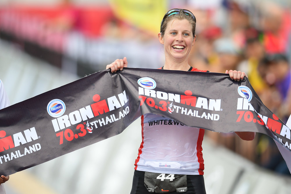 PHUKET, THAILAND - NOVEMBER 26: Imogen Simmonds of Switzerland crosses the finish line in 1st place for the Women's Pro-Triathlete during the Foremost Ironman 70.3 Thailand 2017 at Laguna Phuket, Cherngtalay, Phuket, Thailand on November 26, 2017. (Photo by: Naratip Srisupab/SEALs Sports Images)