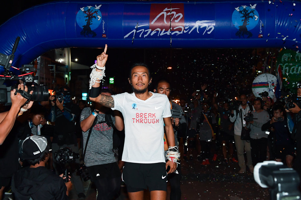 CHIANG RAI, THAILAND - DECEMBER 25: Artiwara Toon Bodyslam Kongmalai crossing the finish line at Mae Sai Border completing his milestone run of Kao Konla Kao, Chiang Rai, Thailand on December 25, 2017. (Photo by: Naratip Srisupab/SEALs Sports Images)