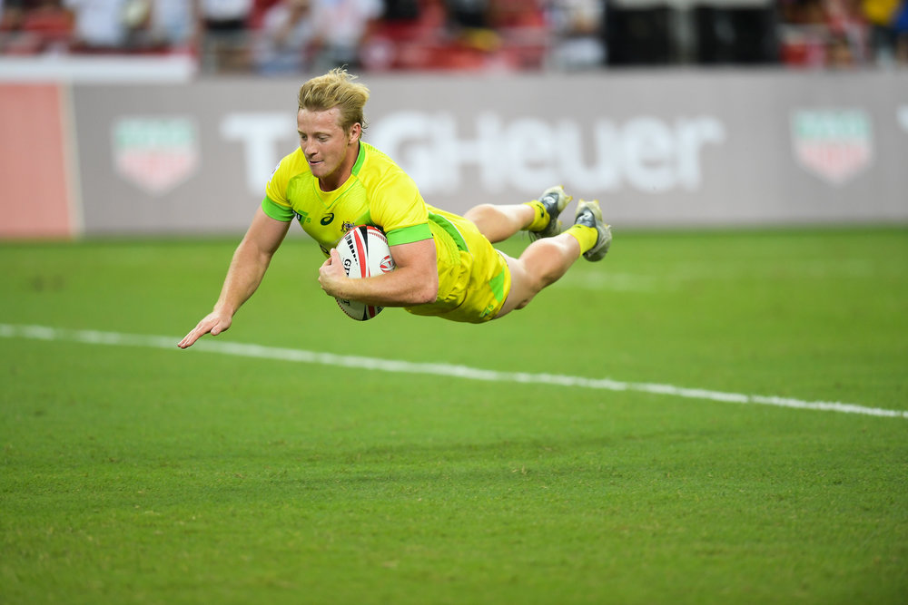 SINGAPORE - APRIL 29: Lachie Miller (#4) of Australia diving for a try during Cup Finals Fiji vs Australia at the HSBC World Rugby Seven Series 2018, Singapore National Stadium, Singapore on April 29, 2018. (Photo by: Naratip Golf Srisupab/SEALs Sports Images)