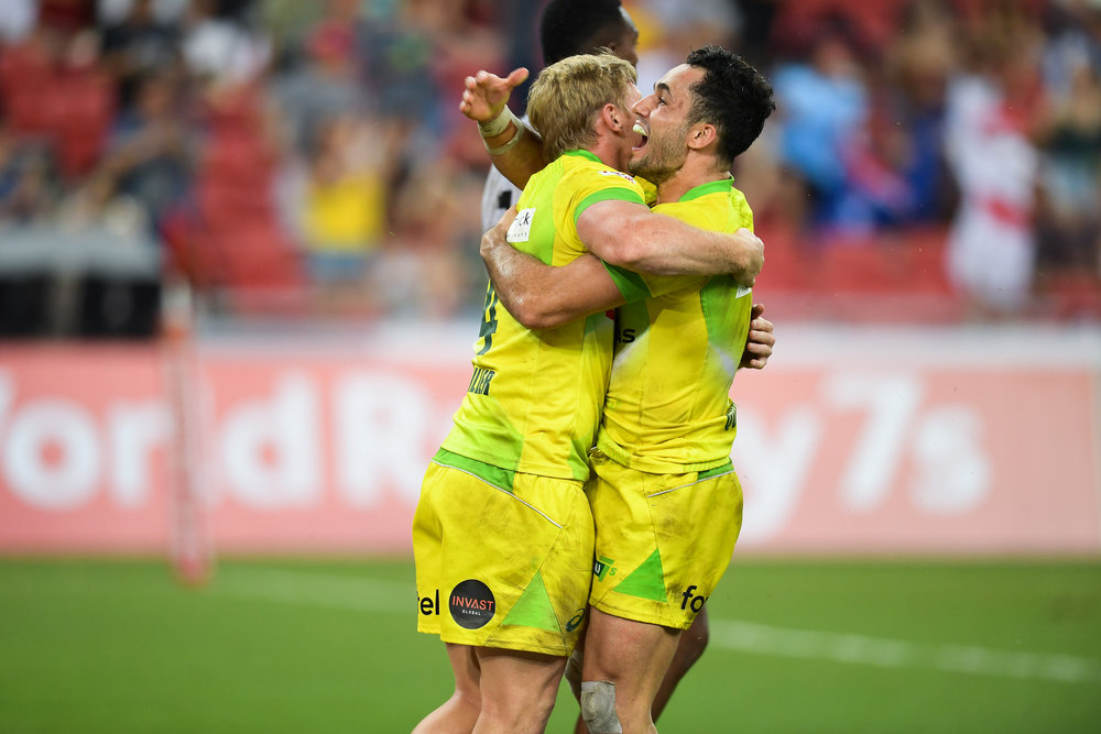 SINGAPORE - APRIL 29: Lachie Miller (#4) and Brandon Quinn (#9) of Australia celebrate what ought to be a winning try during Cup Finals at the HSBC World Rugby Seven Series 2018, Singapore National Stadium, Singapore on April 29, 2018. (Photo by: Naratip Golf Srisupab/SEALs Sports Images)