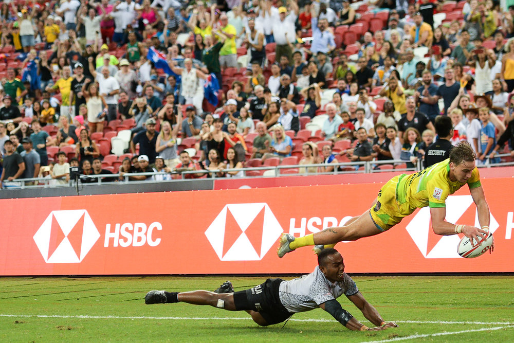 SINGAPORE - APRIL 29: John Porch (#6) of Australia diving for a try during Cup Finals Fiji vs Australia at the HSBC World Rugby Seven Series 2018, Singapore National Stadium, Singapore on April 29, 2018. (Photo by: Naratip Golf Srisupab/SEALs Sports Images)