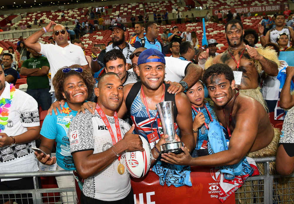 SINGAPORE - APRIL 29: Isake Katonibau (#5) of Fiji celebrate with their fans after the Cup Finals at the HSBC World Rugby Seven Series 2018, Singapore National Stadium, Singapore on April 29, 2018. (Photo by: Naratip Golf Srisupab/SEALs Sports Images)