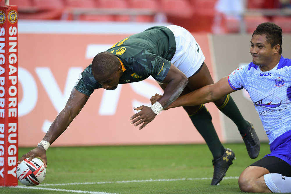 SINGAPORE - APRIL 28: Siviwe Soyizwapi (#11) of South Africa iscoring a try during Match 4 South Africa vs Samoa at the HSBC World Rugby Seven Series 2018, Singapore National Stadium, Singapore on April 28, 2018. (Photo by: Naratip Golf Srisupab/SEALs Sports Images)