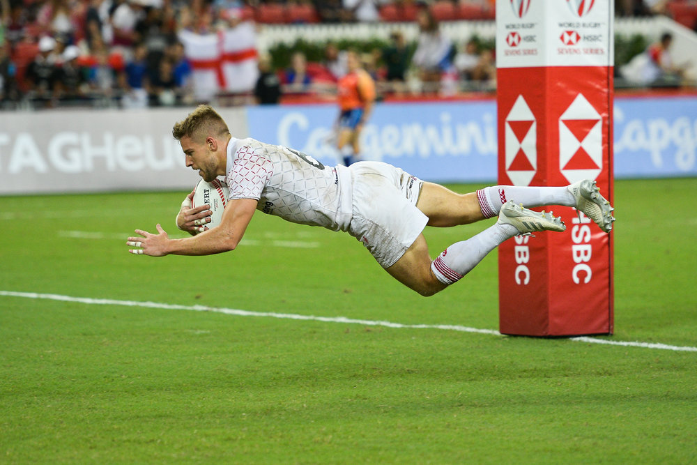 SINGAPORE - APRIL 29: Tom Mitchell (#6) (c) of England scoring a try during Bronze Medals South Africa vs England at the HSBC World Rugby Seven Series 2018, Singapore National Stadium, Singapore on April 29, 2018. (Photo by: Naratip Golf Srisupab/SEALs Sports Images)