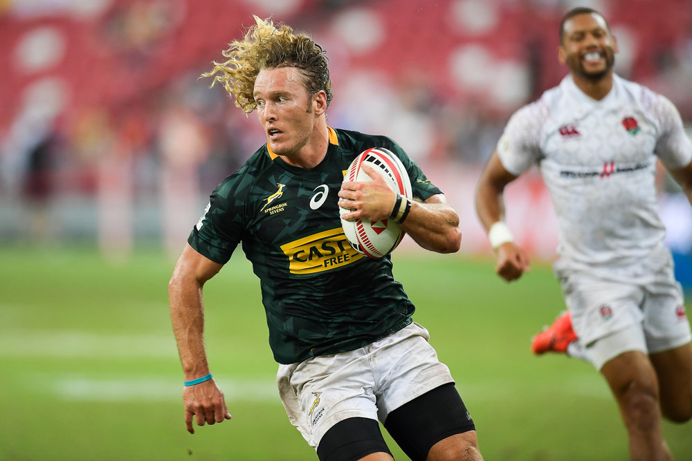 SINGAPORE - APRIL 29: Werner Kok (#5) of South Africa in action during Bronze Medals South Africa vs England at the HSBC World Rugby Seven Series 2018, Singapore National Stadium, Singapore on April 29, 2018. (Photo by: Naratip Golf Srisupab/SEALs Sports Images)