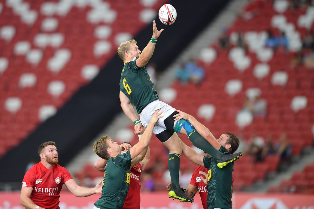 SINGAPORE - APRIL 28: Kyle Brown (#6) (c) of South Africa in action during Match 12 South Africa vs Canada at the HSBC World Rugby Seven Series 2018, Singapore National Stadium, Singapore on April 28, 2018. (Photo by: Naratip Golf Srisupab/SEALs Sports Images)