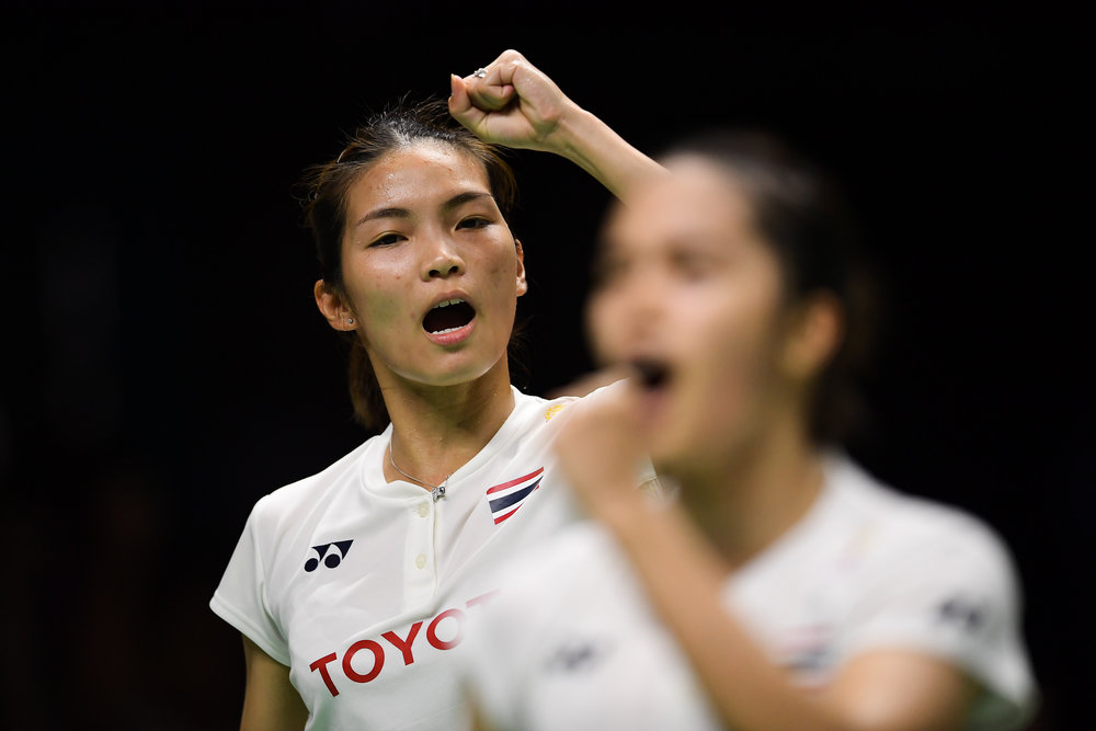 BANGKOK, THAILAND - MONTH 25: Jongkolphan Kititharakul of Thailand and her partner reaction on Court 1 during their Semi-Finals at the BWF Total Thomas and Uber Cup Finals 2018, Impact Arena , Bangkok, Thailand on May 25, 2018.