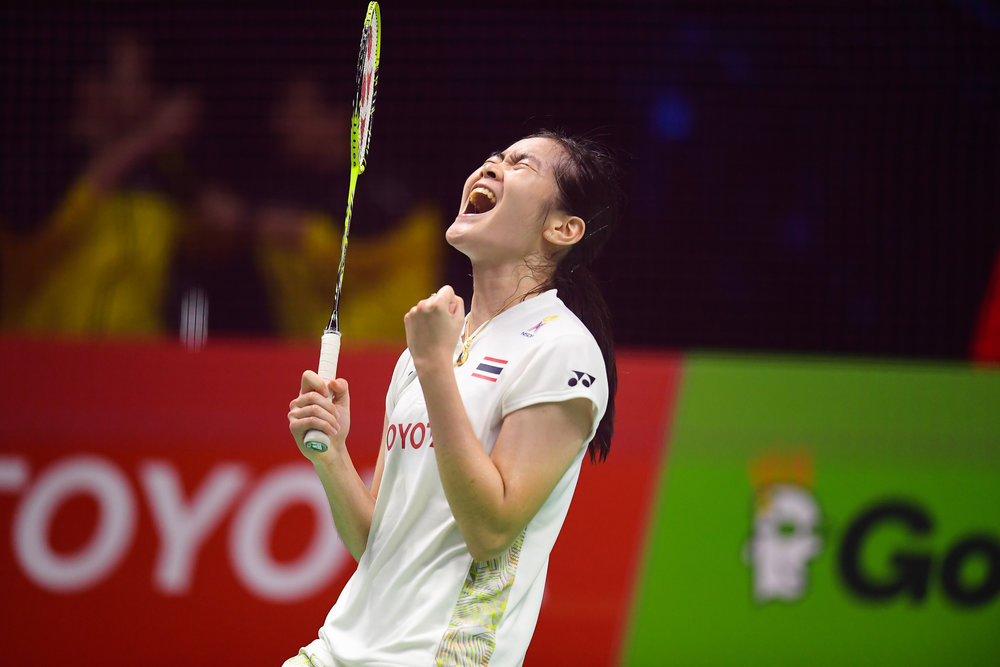 BANGKOK, THAILAND - MONTH 25: Busanan Ongbamrungphan of Thailand reaction on Court 1 after winning her Semi-Finals for Team Thailand at the BWF Total Thomas and Uber Cup Finals 2018, Impact Arena , Bangkok, Thailand on May 25, 2018.